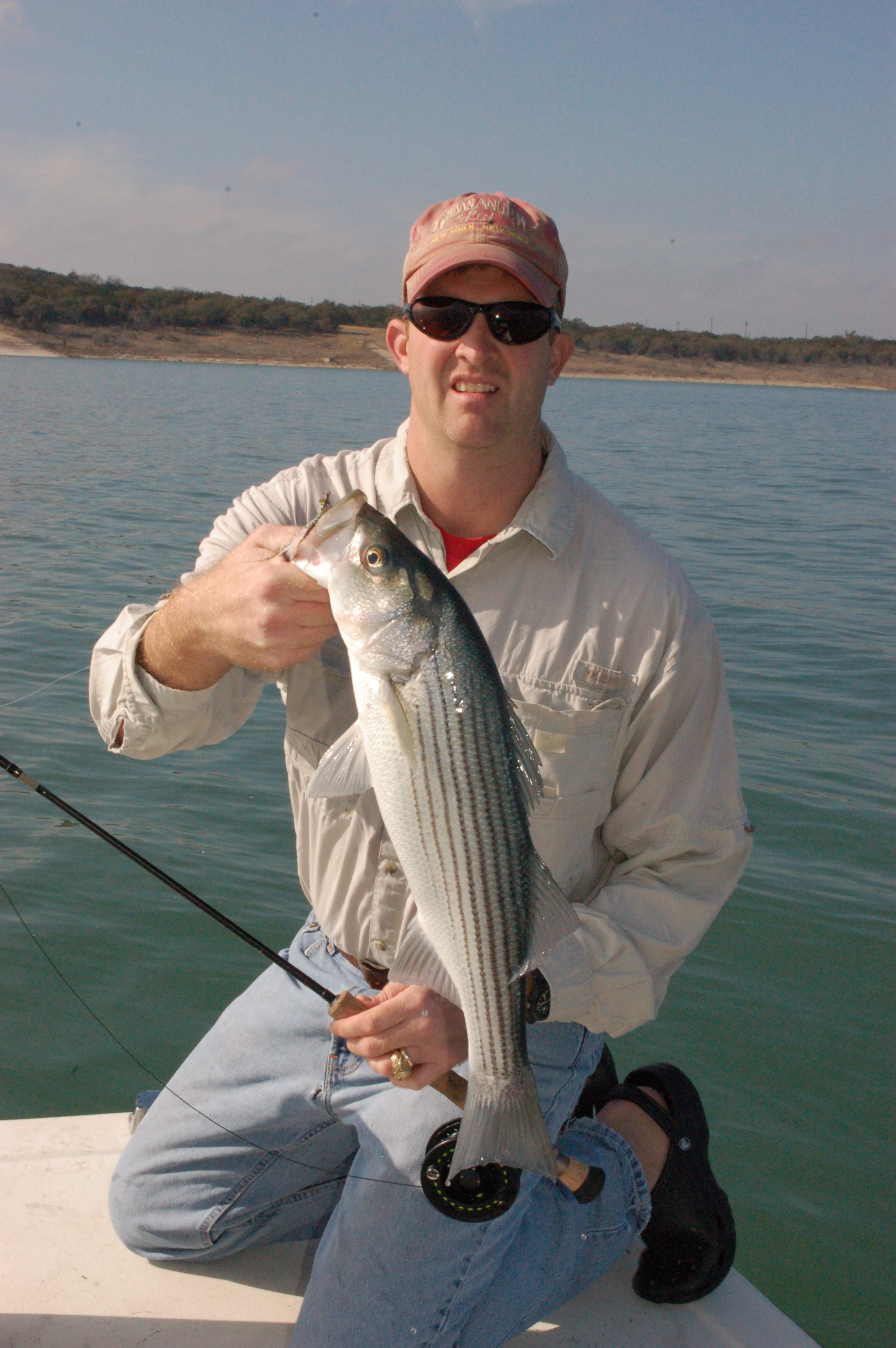 Jon fisher with striper 1 for Fl fishing report